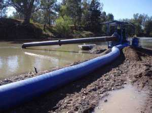 Experimental pumping station showing typical deployment into water adjacent to a gravel bar (Photo courtesy of Craig Boys)