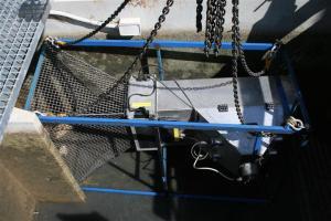 Figure 2. Installing the vaki riverwatcher into the lock 10 fishway (Photo courtesy of Lee Baumgartner)