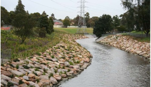 A reach of the Cooks River prior to and after naturalisation